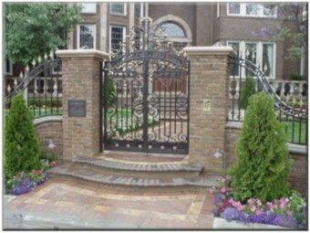 Hand Forged Steel Entry gate with a touch of bronze.